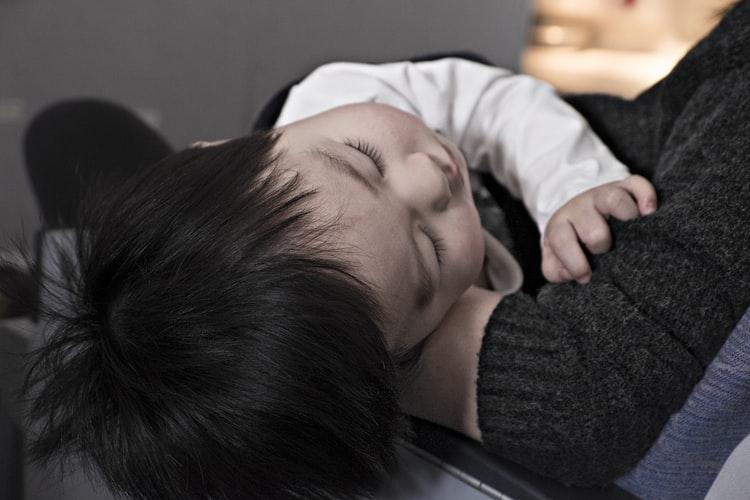 Sleepy baby with Babysitter