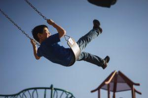 Kid at playground - Explore Childcare Careers