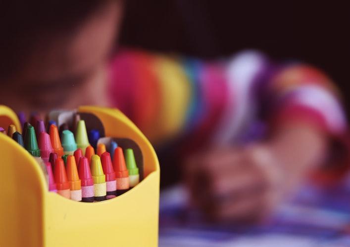 Creche Teacher providing fun activities to kids
