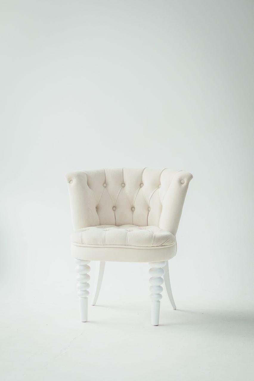 Furniture designer displaying a chair.
