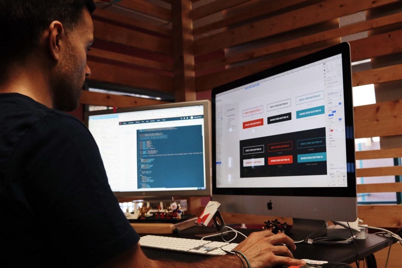 Web developer working on a website using a computer