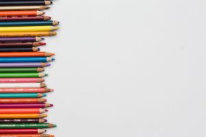 Different colour pencils lined up horizontally