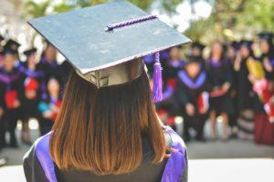 A students wearing graduation regalia