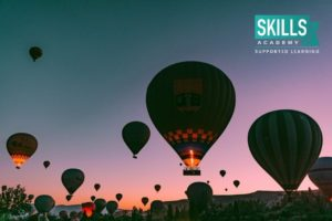 Air ballons lit up in the sky for travelles