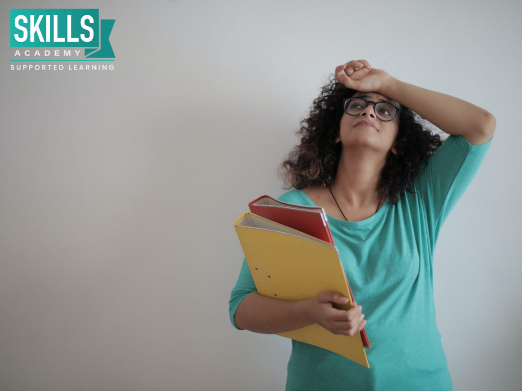 """Women holding books wondering """"Should I Study Part-Time?"""" Read on Below for more information."""