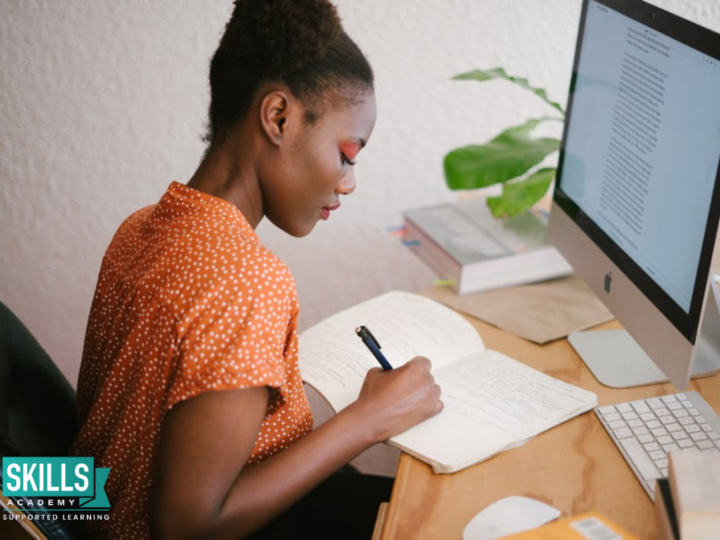 A student writing her essay. Find Essay Writing Tips here.