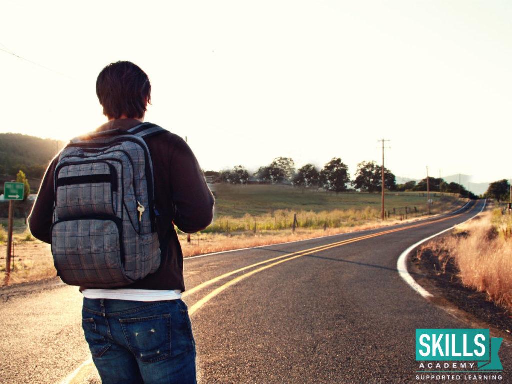 "Student walking down a road, wondering, ""Should I Take a Gap Year?"""