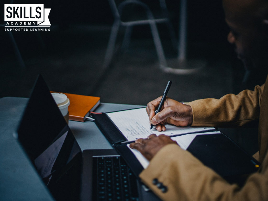 Teacher marking answer sheets in a classroom. Learn more about Recheck vs. Remark for Matric Results Right here.