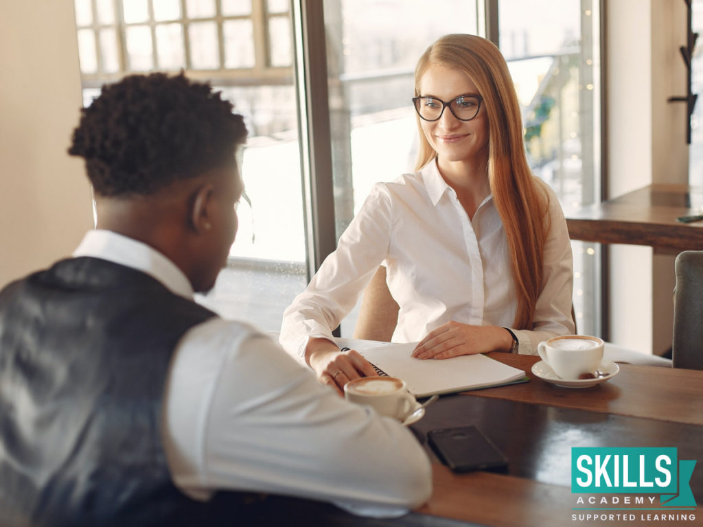 Young man being interviewed by a woman. Find Ways to Highlight Your Strengths During an Interview right here.