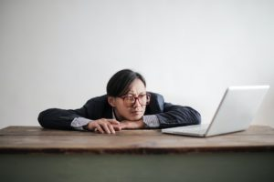 Man using his laptop to search How to Break Bad Work Habits