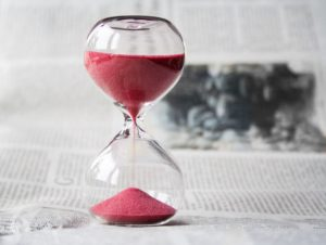 Sand running through an hourglass. Ways to Manage Your Time Well can be this simple.