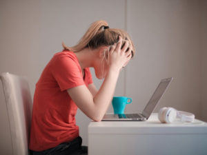Woman sitting in front of laptop. Here are your options if you failed matric